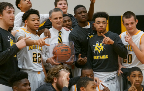 Boys' basketball celebrates 100th program win under Vozza