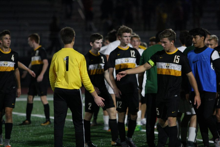 Senior+Ethan+Ytterberg+shakes+hands+with+Waubonsie+Valley%27s+goalie+after+a+3-2+victory.