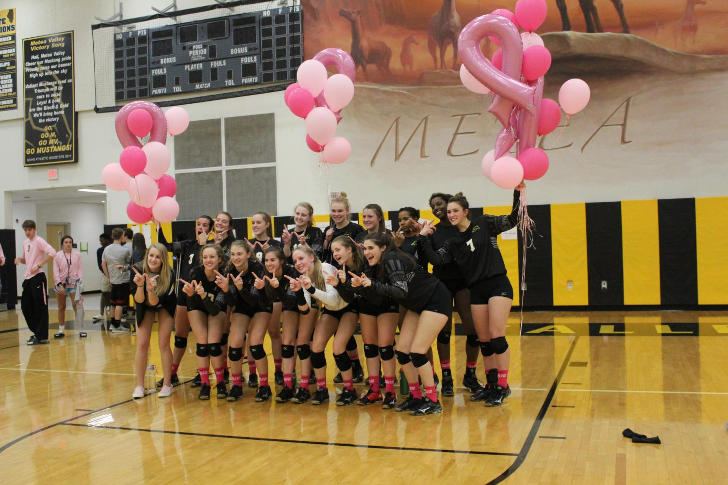 Girls Volleyball plays in honor of breast cancer