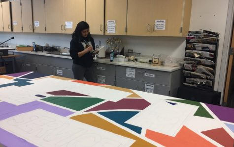 National Art Honors Society creates mural for Loaves and Fishes