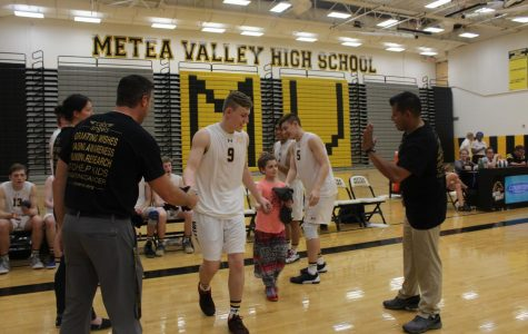 "Boys' Volleyball ""Goes Gold"" in conference game"