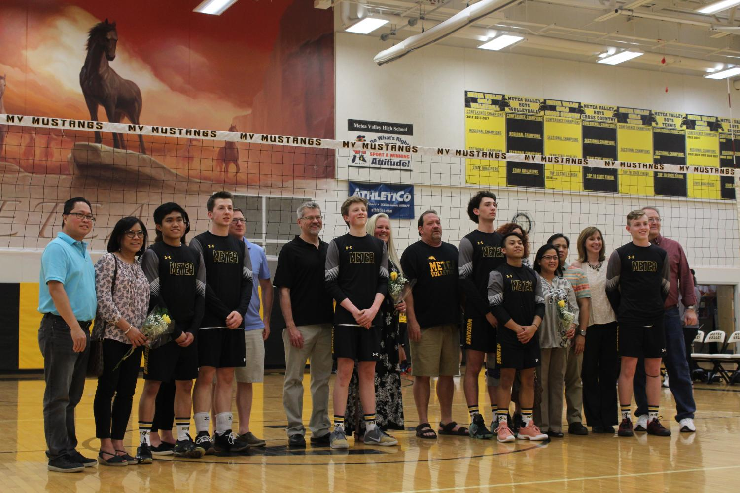 Each+senior+was+celebrated+with+their+coaches+and++families.