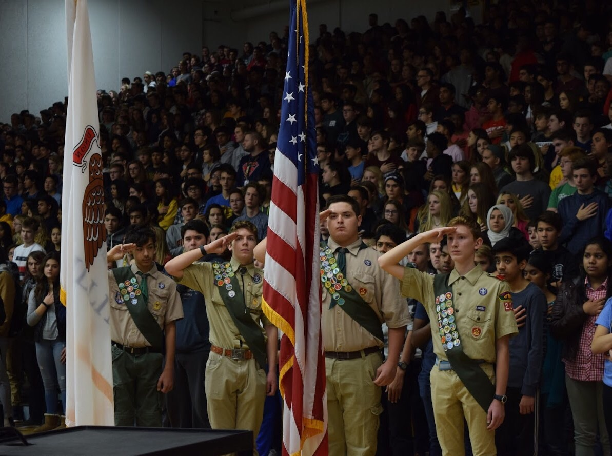 Metea+students+and+Boyscouts+stand+with+pride+while+saluting+the+American+and+Illinois+flag.