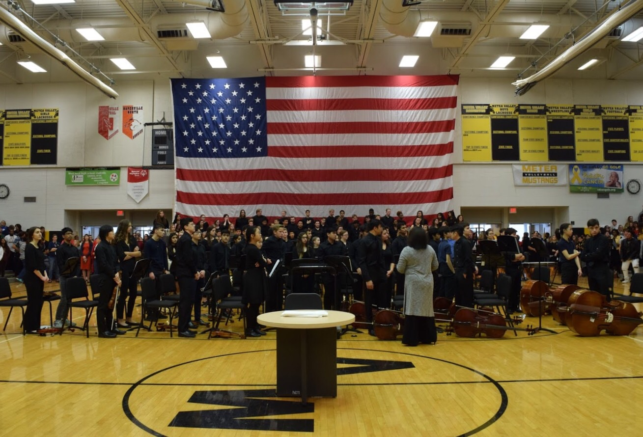 Orchestra+stands+for+the+National+Anthem+during+the+assembly.