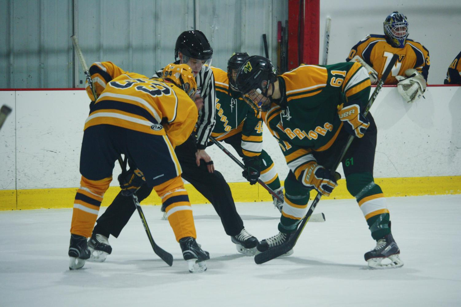 Junior Ethan Wipff faces off in the first period against Neuqua on Thursday night.