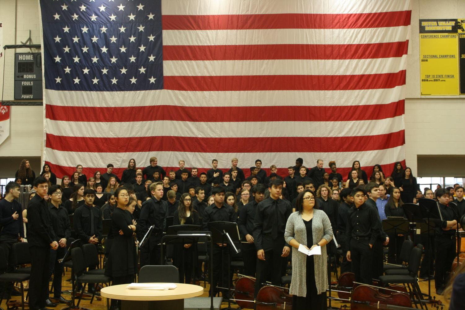 Orchestra faces the boy scouts as they bring in the flags.