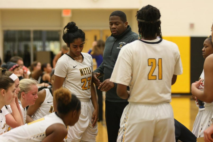 Coach+Williams+talking+to+the+team+during+a+timeout.+