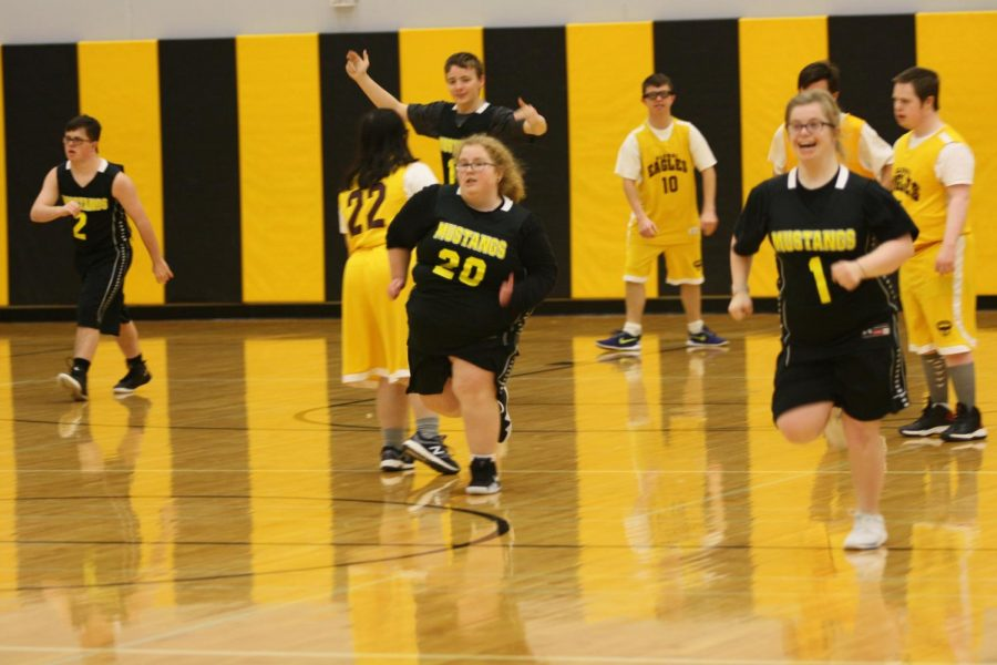 Special Olympics Traditional basketball team during second quarter. Pictured left to right: #2 Jake Martin, #11 Matthew Schuch, #20 Lauren Reed, and #1 Emily DeAngelo