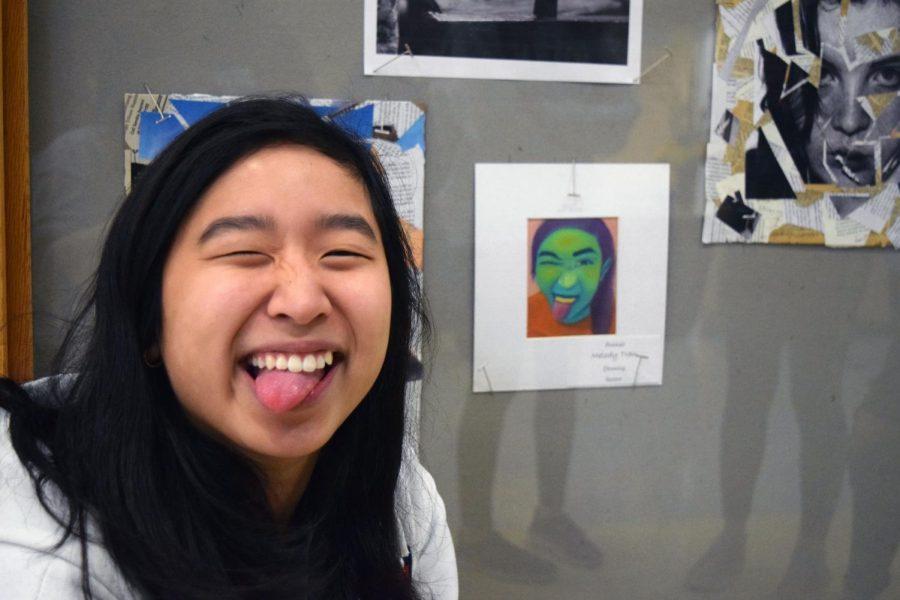 Melanie Tran mimicking Melody Tran's artwork of her.