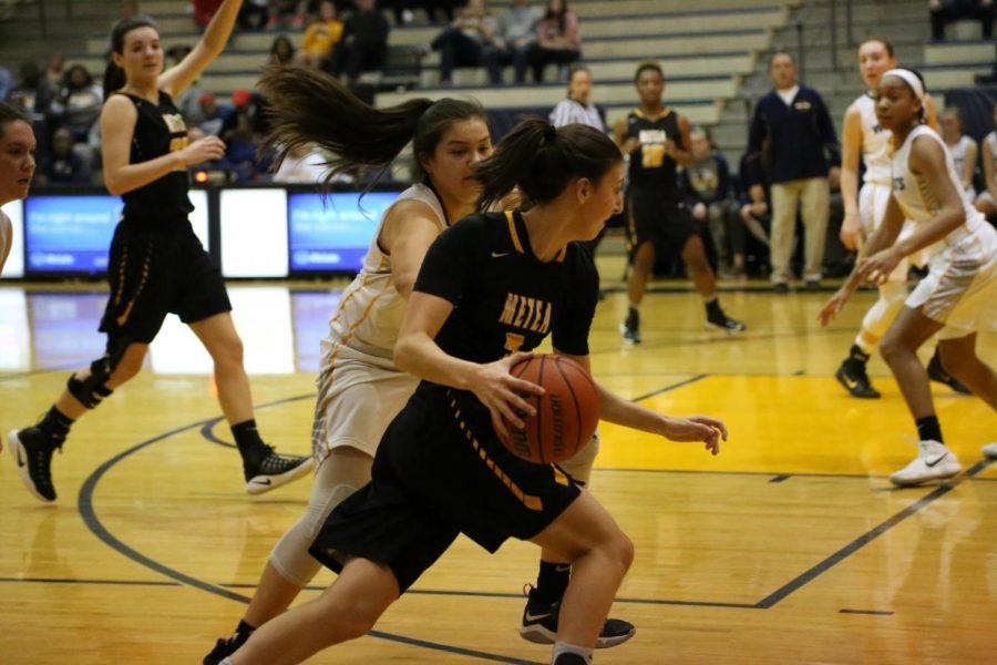 Senior Chloe Kurkjian retrieves the ball down court.