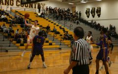 Boys' basketball late surge falls short against #20 Waukegan