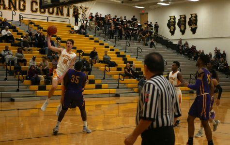 Boys' basketball late surge falls short against #20 Waukegan