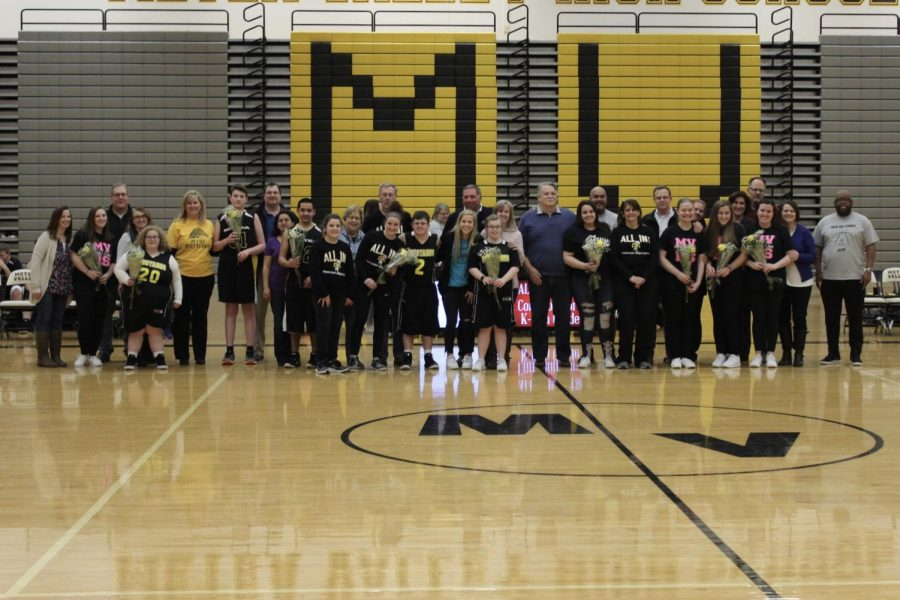 Special+Olympics+seniors+are+honored+before+the+game.+