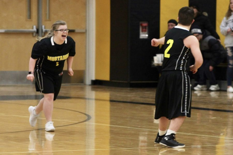 Emily DeAngelo and Jake Martin celebrate a basket.