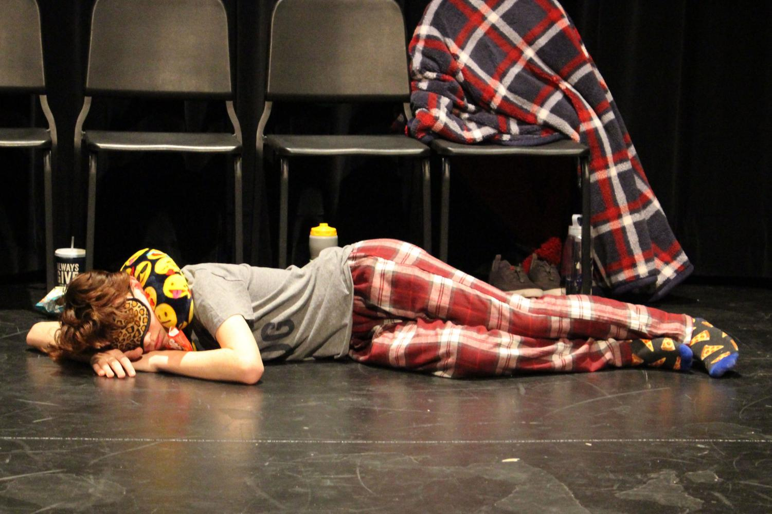 Jake+Zeitner+demonstrating+his+role+as+sloth+by+sleeping+throughout+intermission.