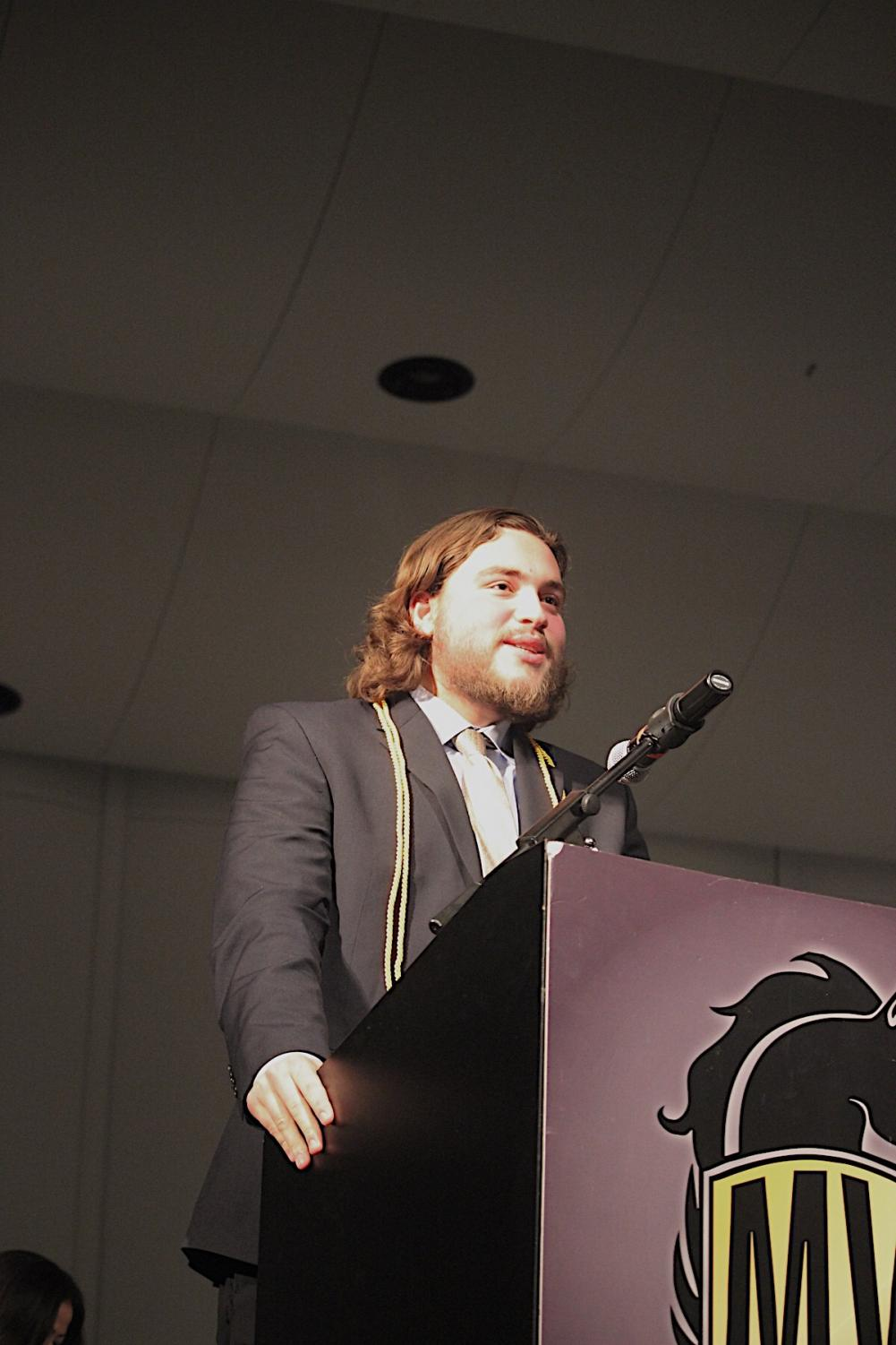 Adam+Smith+delivers+a+speech+and+acknowledges+the+achievements+of+his+colleagues.