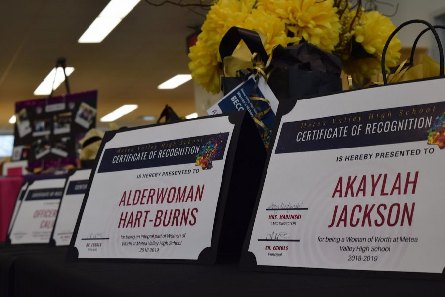 Certificates to honor some woman at the assembly.