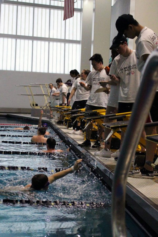 Volunteers getting ready to time the swimmers.