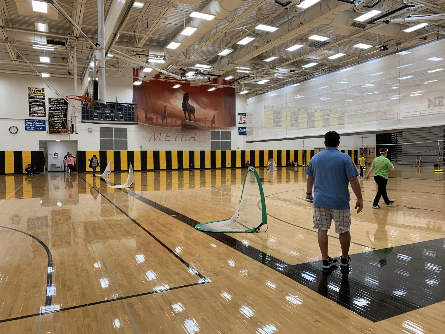 Students file into the gym within the first minutes of school for PE classes.