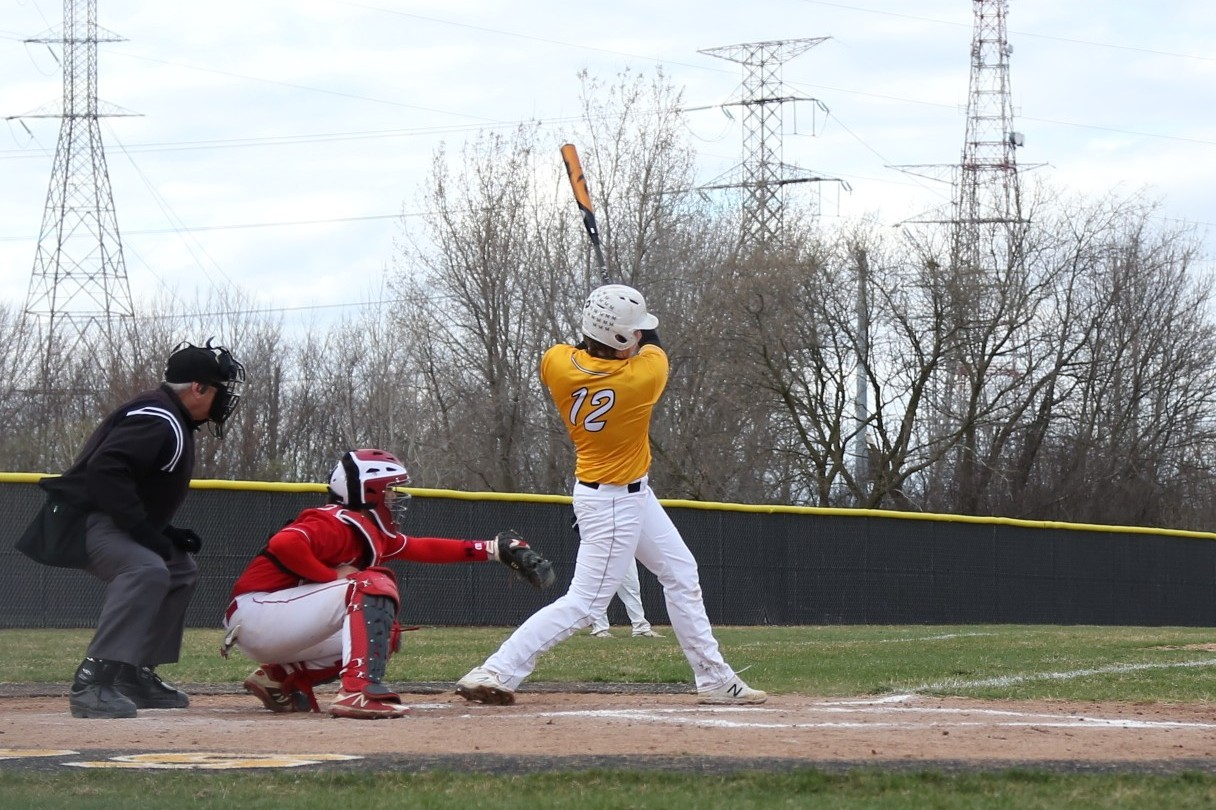 No. 12, Cade Sullivan batting to first base on April 13th against Naperville Central.