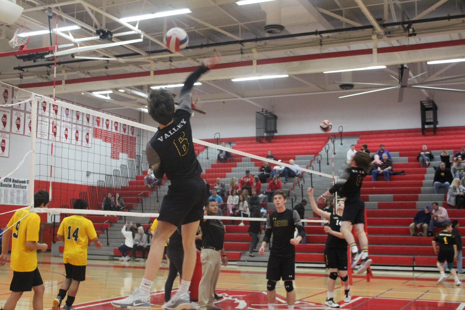 Junior+and+outside+hitter+Tj+Steffgen+warming+up+before+competing+against+Naperville+Central.