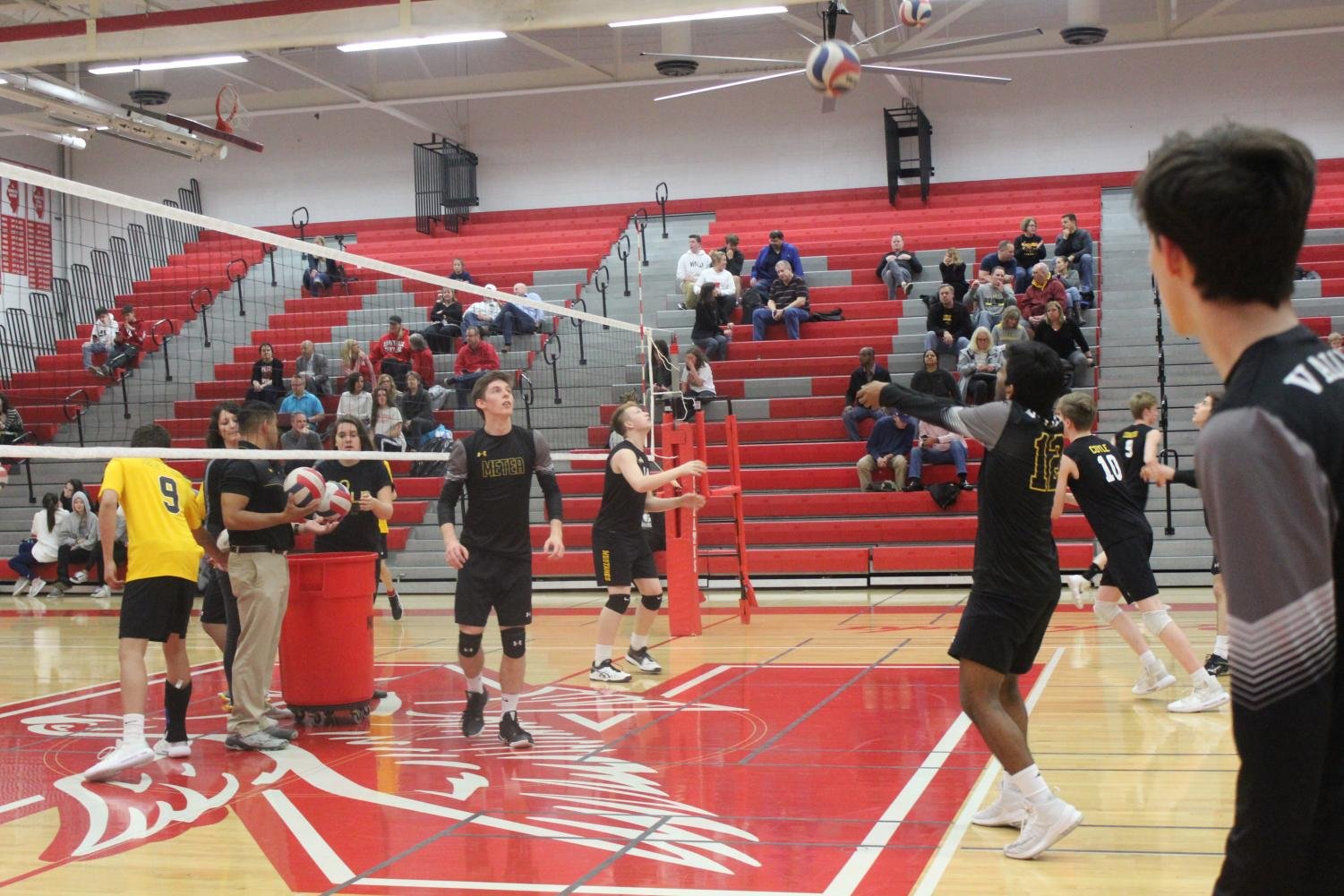 The Mustangs warming up before their match against conference rival Naperville Central.