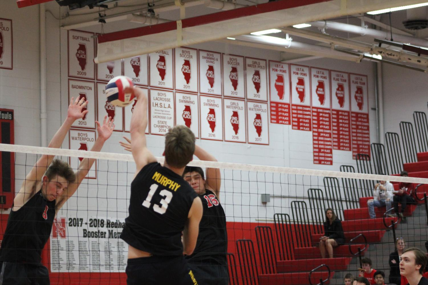 Senior+and+outside+hitter+Conor+Murphy+completes+a+kill+during+the+first+set.
