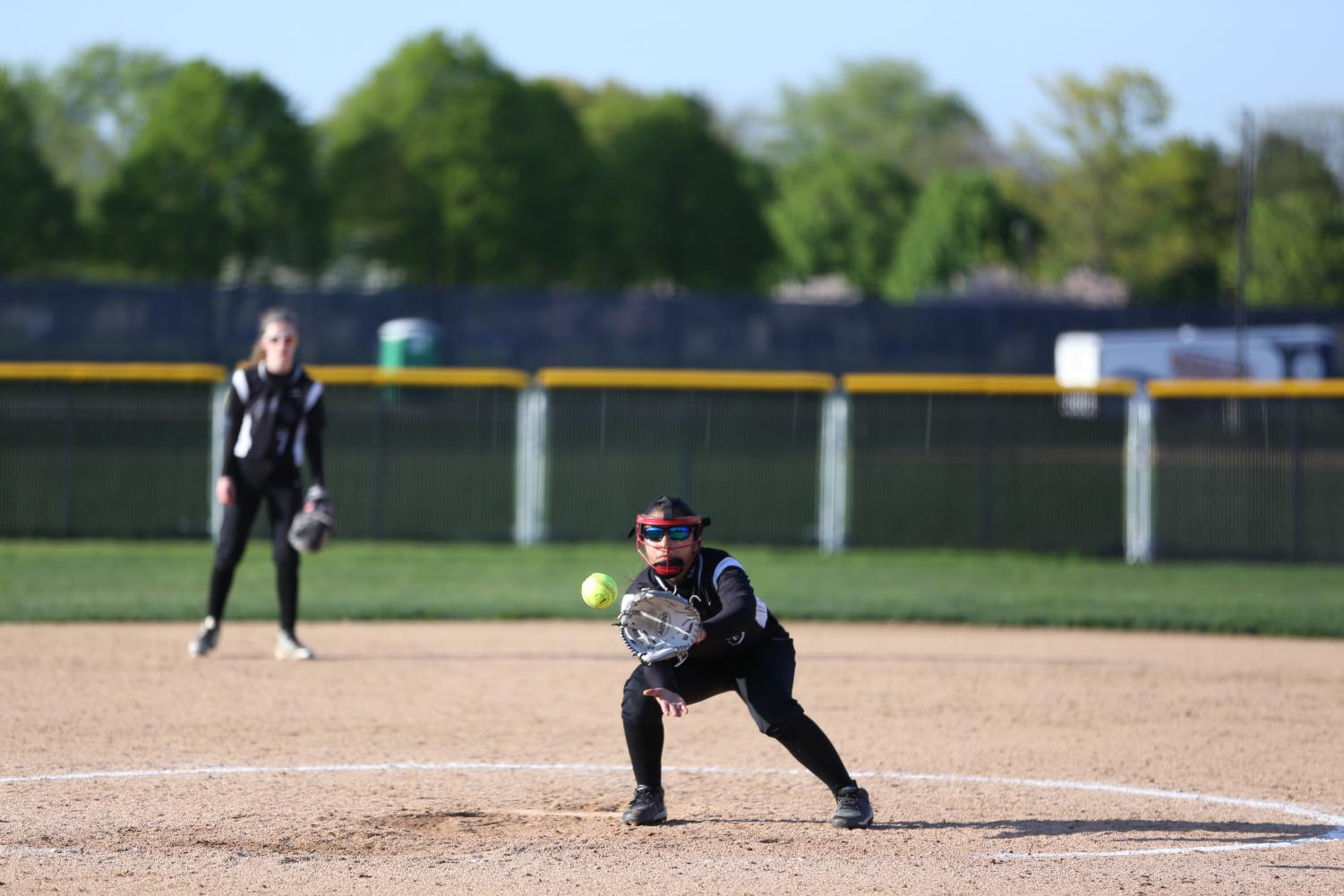 Pitcher+Nevaeh+Cruz++catching+the+ball+from+no.+10+Emily+Finger+during+the+fifth+and+sixth+inning.