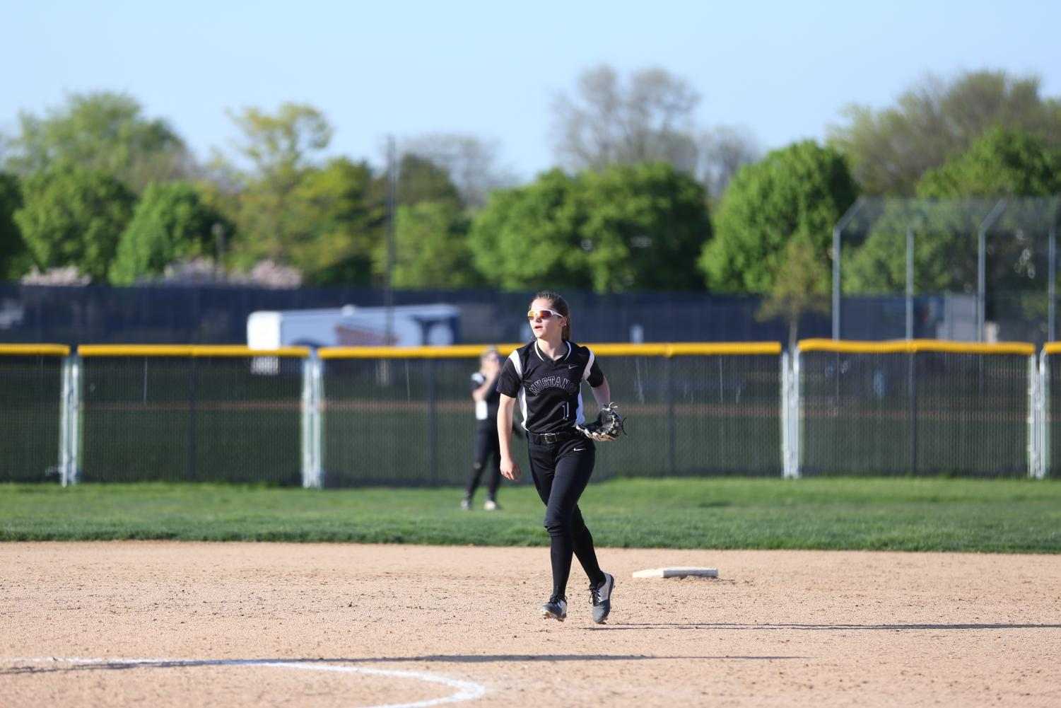 Shortstop+and+second+baseman%2C+Nicole+Orloff+passing+the+ball+to+the+pitcher.
