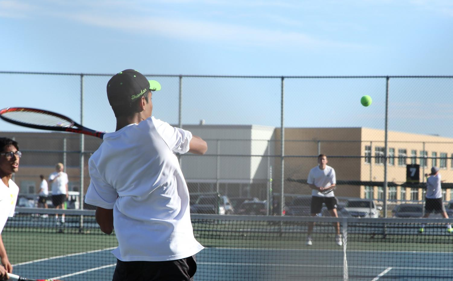 Sophomore Shankar Jambunathan with doubles partner Tanay Vutukuru during their match against St. Charles North on April 9th.