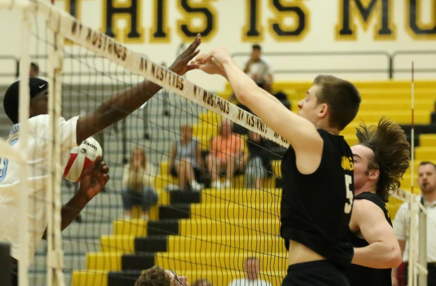 On April 22nd, the boys played against Willowbrook High School. In the second set, outside hitter Ryan Owens blocks the ball.