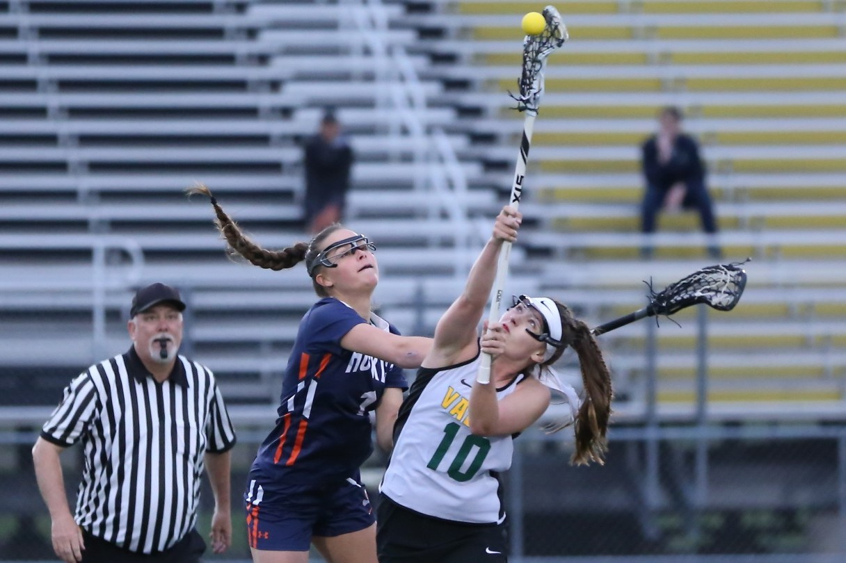 No. 10 Caitlin Beacom faceoff the opposing team Naperville North on April 24th.