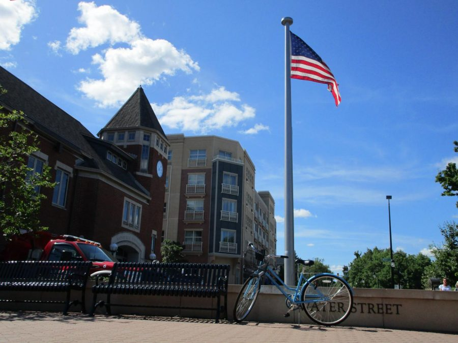 The American Flag waves in front of the Naperville Township building on Water Street