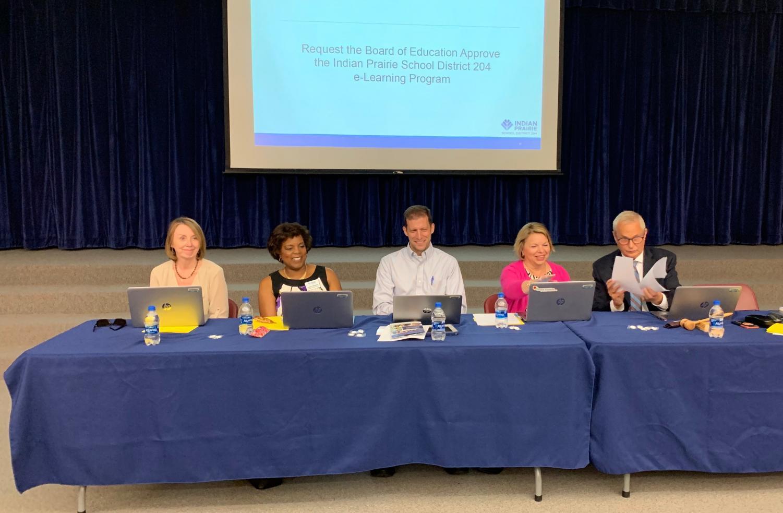 Superintendent Karen Sullivan and School Board members smile after a successful quorum.