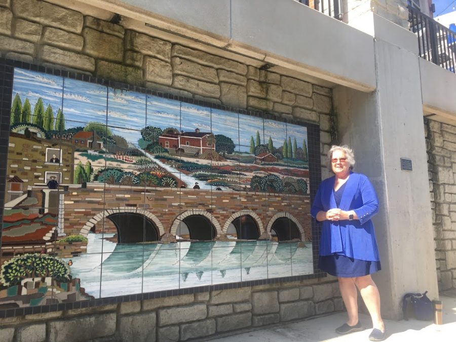 Councilwoman+Judith+Brodhead+and+her+favorite+piece+of+art+located+along+the+River+Walk.