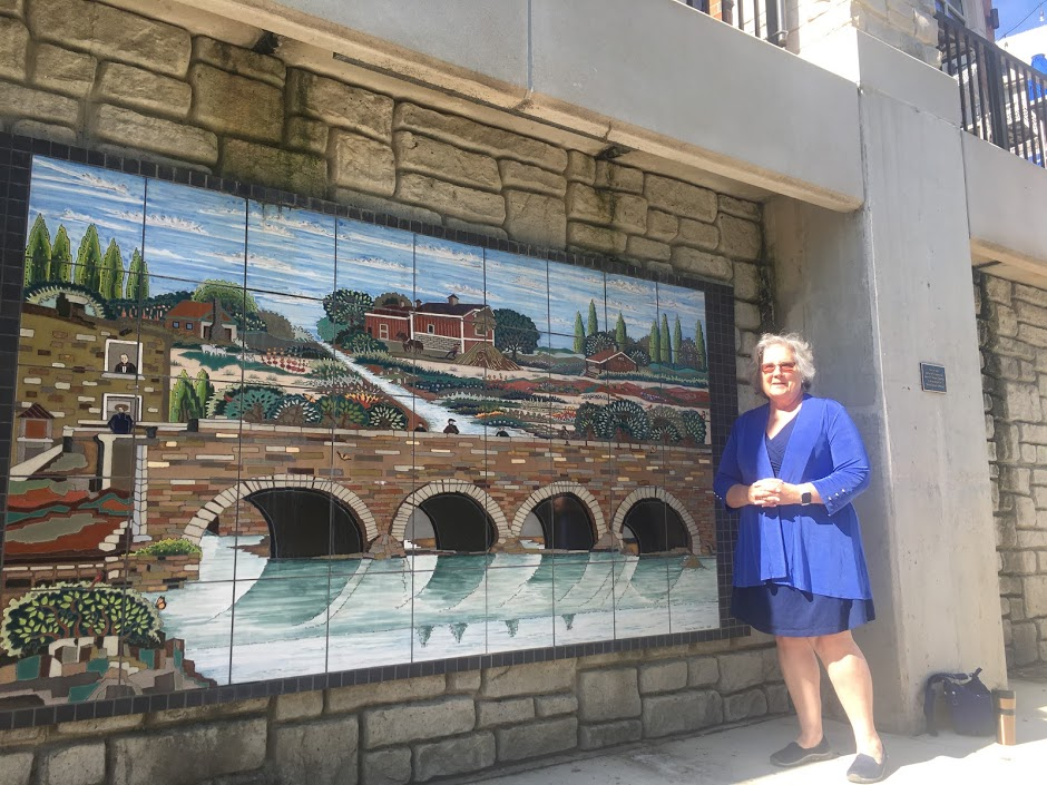 Councilwoman Judith Brodhead and her favorite piece of art located along the River Walk.