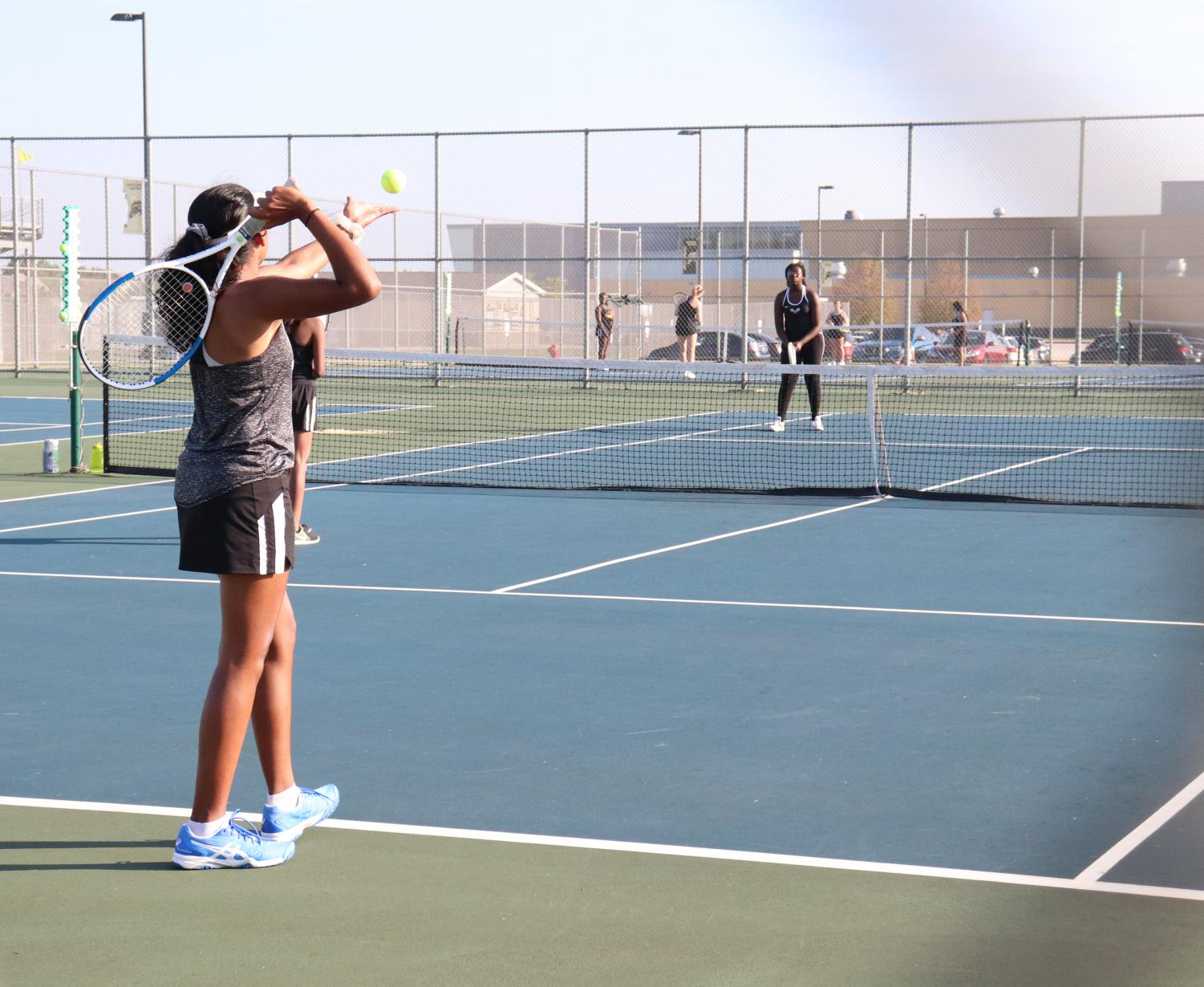 Girls' tennis takes on their opponents on the tennis courts.