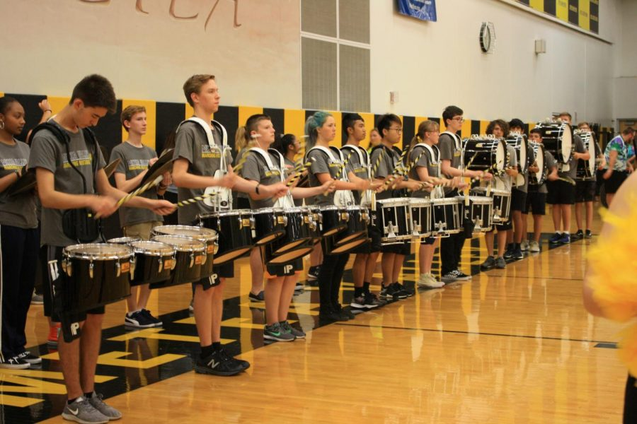 The+Marching+Mustangs+drumline+getting+ready+for+their+performance