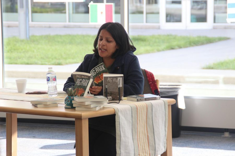 Claudia+Guadalupe+Martinez+reads+part+of+her+book+to+the+students.