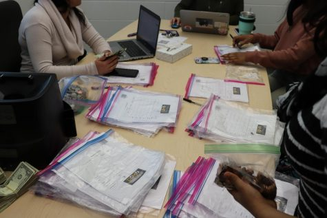 Numerous donations are counted by students