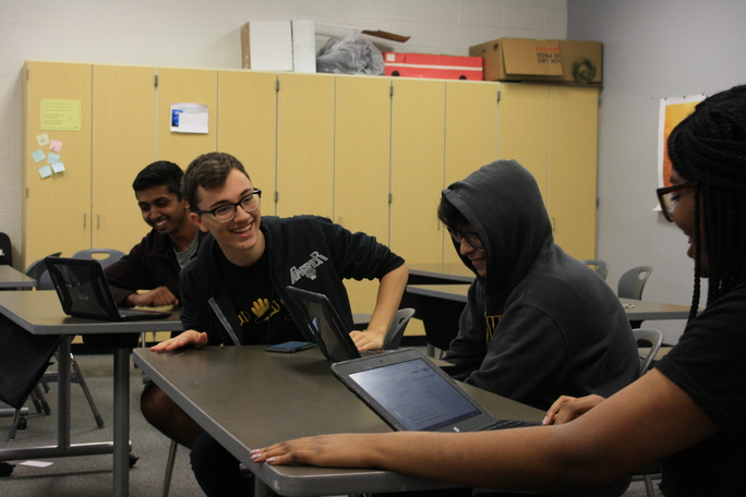 Members of Metea's new sketch comedy team laugh while trying to rehearse a sketch for the October show.
