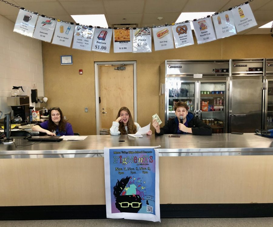 "Parent and student volunteers sell tickets for the play ""Figments"""