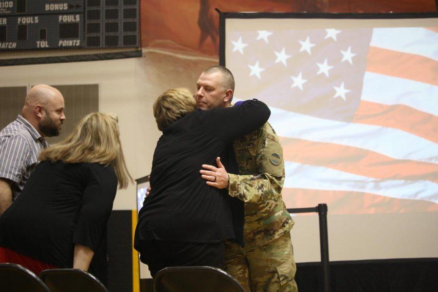Sgt. Maj. Barry Kulinski hugs his family.