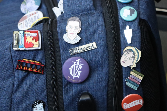 Claire sports her fandom spirit with buttons and trinkets adorning her backpack.