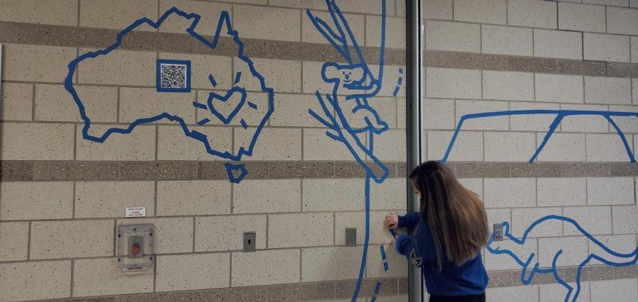 Senior+Thalia+Bowen+works+on+the+tape+mural+dedicated+to+the+Austrailia+fires.