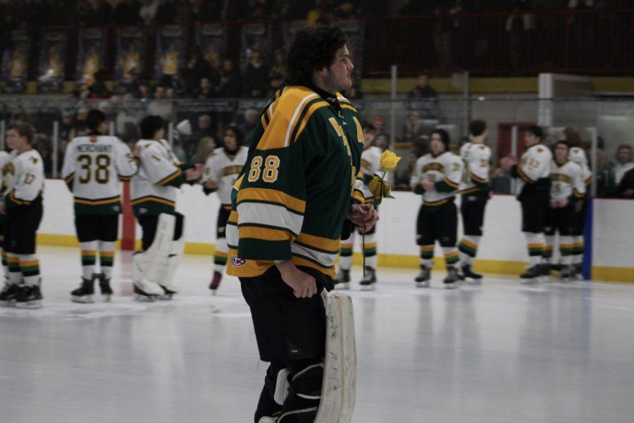 Senior Justin Howard skates over to his parents on senior night.