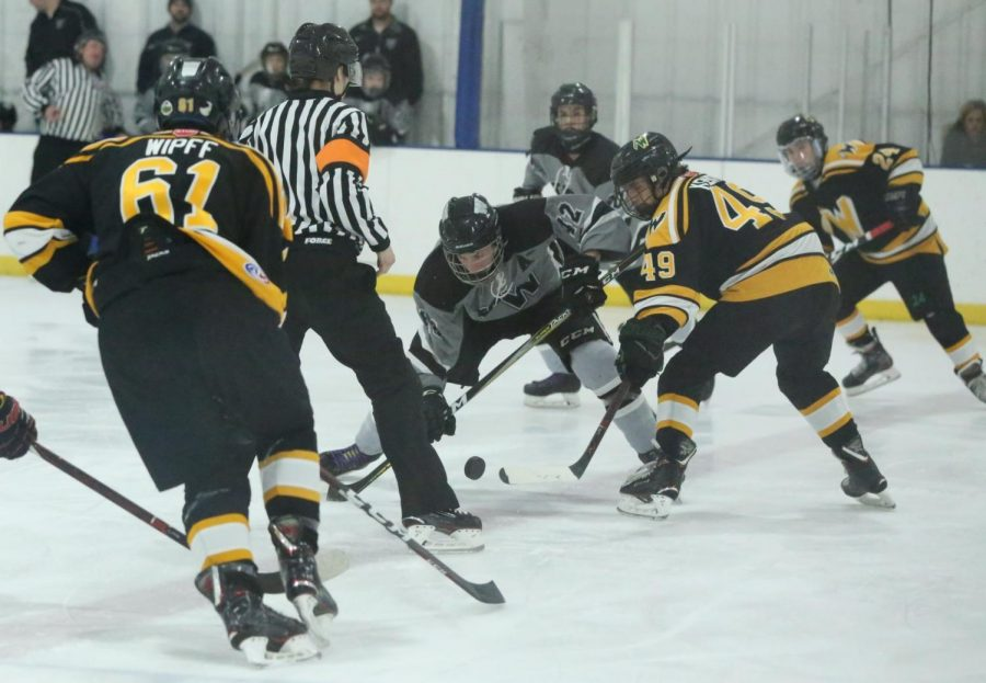 Center-man+Trent+Kenyon+looks+to+gain+control+of+the+puck+and+pass+to+another+teammate.