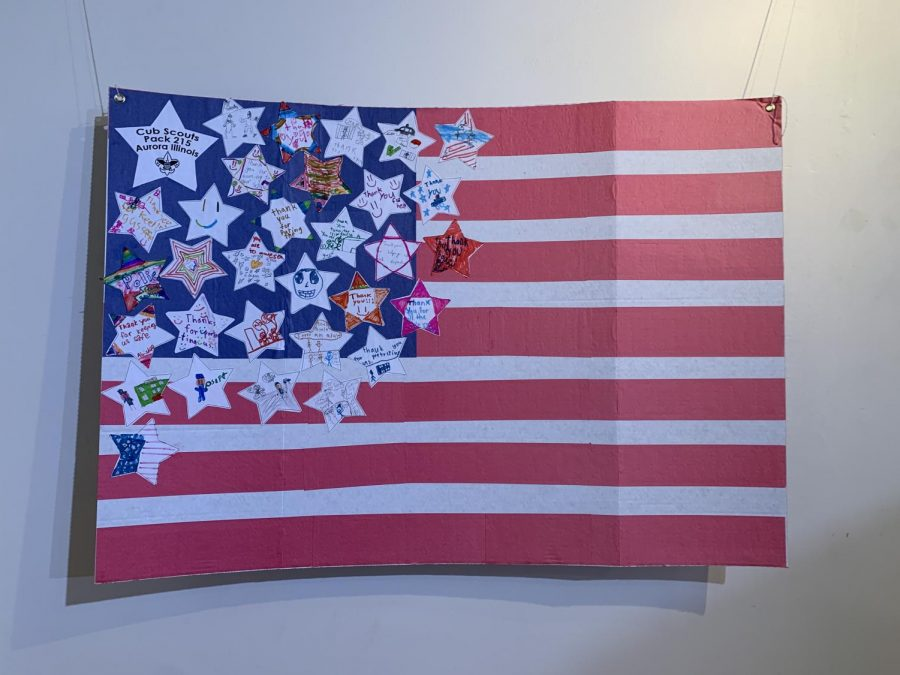 An+American+flag+from+a+Cub+Scout+troop+hangs+in+the+memorial+along+with+other+items+bearing+the+American+flag.