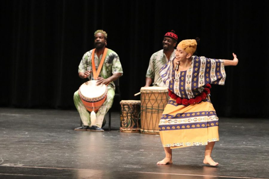Performers dance to the Djemebe  drums with joy.