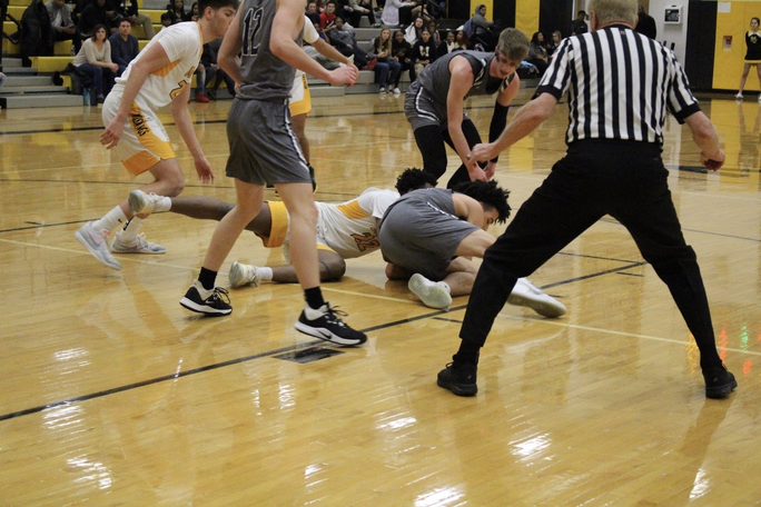 #22 goes for the ball on the floor against an Oswego East player.